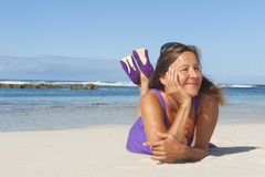 Sexy Mature Woman in Purple Dress VIII. Portrait of an attractive looking mature woman in her fifties enjoying her early retirement with a vacation at sea Stock Images
