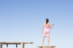 Sexy mature woman in summer dress on blue sky Royalty Free Stock Photo