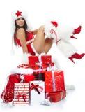 Sexy meisje dat de kleren van de Kerstman draagt stock afbeeldingen