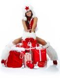 sexy meisje dat de kleren van de Kerstman draagt royalty-vrije stock fotografie