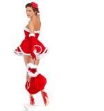 Sexy meisje die de kleren van de Kerstman dragen royalty-vrije stock foto