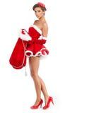 Sexy meisje die de kleren van de Kerstman dragen Stock Foto