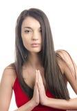 Sexy meisje in het rode kleding bidden Stock Foto