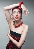 Sexy meisje met aardbeibraclet en halsband royalty-vrije stock foto