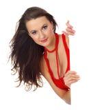 Sexy meisje met rode vertoning Royalty-vrije Stock Foto