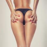 Sexy meisjesuiteinde, zonder cellulite Stock Afbeelding