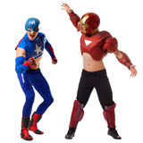 Sexy men dressed in costumes of superheroes Stock Images
