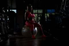 Sexy Mexican Woman Resting In The Gym Royalty Free Stock Image