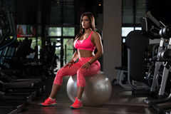 Mexican Woman Resting In The Gym Royalty Free Stock Image