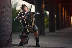 military armed girl with the weapon, sniper royalty free stock image