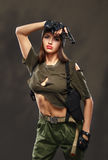 Sexy military girl with gun. Royalty Free Stock Images