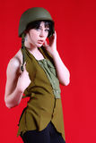 Military Girl. Pretty Female Isolated on a red background in a Fashion Pose stock photos