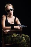 military woman posing with gun Royalty Free Stock Photo
