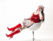 Sexy Miss Santa with boots Stock Images