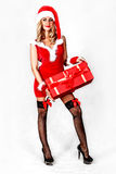 Sexy miss Santa with a present Stock Photo