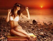 Sexy model on the beach on sunset Royalty Free Stock Image