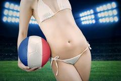 Sexy model with bikini and ball in stadium Stock Photos