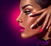 Model with brown skin and purple lips. Over dark background royalty free stock photos