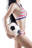 Sexy model carrying soccer ball Stock Photo
