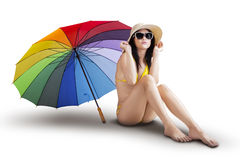 Sexy model with colorful umbrella isolated Royalty Free Stock Image