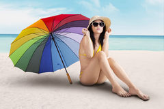 Sexy model with colorfull umbrella at beach Royalty Free Stock Photos