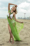 model in design bikini and cover up posing on the beach. stock photo