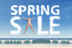 Sexy model forming spring sale text Royalty Free Stock Image