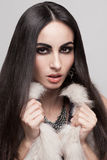Sexy model in fur vest Stock Photo