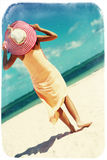Sexy model girl  in colorful cloth and sunhat behind blue beach Royalty Free Stock Image