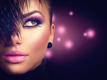 Model girl with holiday purple makeup. Model girl face closeup with holiday bright purple makeup stock photos