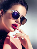 Sexy model girl wearing sunglasses Royalty Free Stock Photos