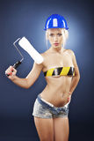 Sexy model holding a roller brush. Royalty Free Stock Images