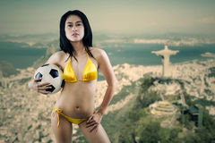 Sexy model holding soccer ball Royalty Free Stock Photo