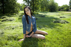 Sexy model in jeans clothes Royalty Free Stock Photos