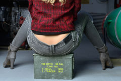 Sexy model with jeans sitting on a batlle ship Stock Image