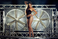Sexy model in lingerie on a stage turbo fan Royalty Free Stock Image