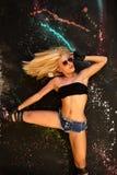 Model posing over paint splash. Model in jeans shorts posing over paint splash royalty free stock image