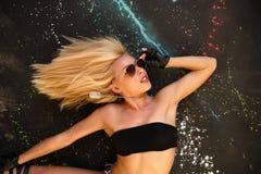 Model posing over paint splash. Model in jeans shorts posing over paint splash royalty free stock images