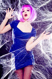 Sexy model with purple wig and intense make-up Stock Image