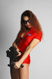 Sexy model in red with tommy-g Stock Photography