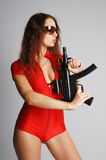 Sexy model in red with tommy-gun Royalty Free Stock Image