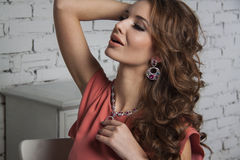 Sexy model with shiny jewelry and curly volume hair Stock Photos