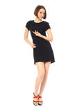Sexy model in short black dress isolated on white. Sexy model in short black dress isolated Stock Images