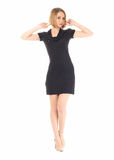Sexy model in short black dress isolated on white. Sexy model in short black dress isolated Stock Photo