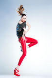 model with slim body dressed in red jumping and screaming in the studio Stock Photos