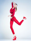 model with slim body dressed in red jumping in the studio royalty free stock images