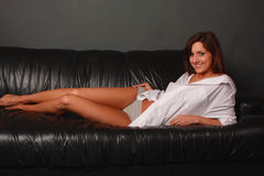 Sexy model on sofa Stock Image