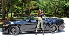 model in sport car beautiful girl with a Ford mustang Roush stage 3 900 HP horse power muscle car. royalty free stock photography