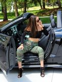 Sexy model in sport car beautiful girl Stock Photos