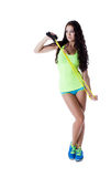 Sexy model in sportswear posing with skipping rope Royalty Free Stock Image